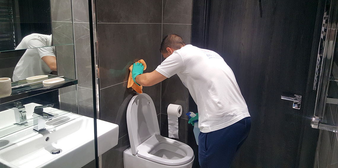 VIP Toilet Cleaner during process of cleaning in London